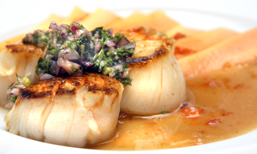 Seared Diver Scallops with Red Papaya, Honey Lime Sauce and Red Onion Salsa