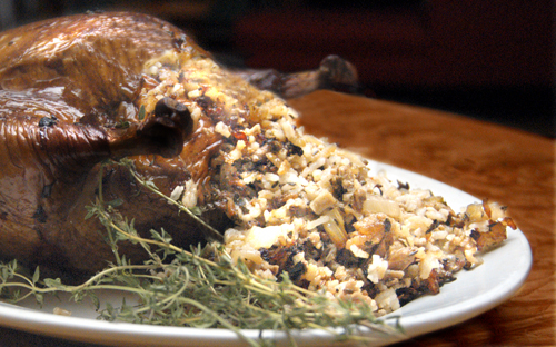 Tuscan Wood-Roasted Chicken with Porcini & Sausage Rice Stuffing