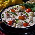 Raita – Indian-style Yogurt Salad with Tomatoes, Peanuts and Mint